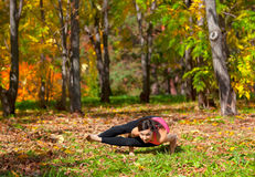 Yoga ashtavakrasana pose Stock Photography