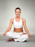 Yoga - asiento del loto Imagen de archivo libre de regalías