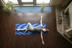 Free Yoga At Home: Revolved Abdomen Pose Royalty Free Stock Photography - 78085067