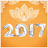 Yoga background with symbol of new year 2017 and decoration Royalty Free Stock Photos