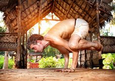 Yoga bakasana in India Stock Photos