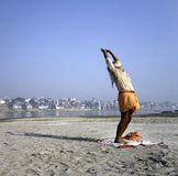 Varanasi, India, hindu sadhu man doing sun salutation yoga ritual at River Ganges Royalty Free Stock Image