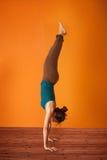 Yoga Balance. Woman in the Adho Mukha Vriksasana Yoga position Stock Photography