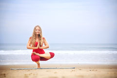 Yoga balancing asana on toes Royalty Free Stock Photos
