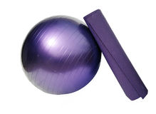 Yoga ball and mat royalty free stock images