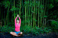 Yoga Bamboo. Woman practicing yoga in bamboo forest Royalty Free Stock Images