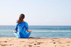 Yoga on beach. Young woman doing yoga on beach Royalty Free Stock Photo