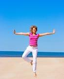 Yoga on a beach Stock Photo