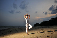Yoga By The Beach Royalty Free Stock Photos