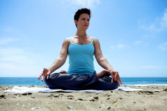 Yoga on the Beach. With legs crossed Stock Photo