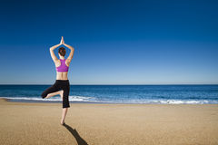 Yoga in the beach Stock Photos