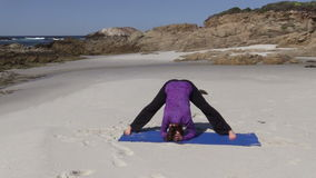 Yoga on the Beach in California stock video footage