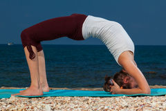 Yoga on the beach Stock Photos
