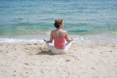 Yoga on the beach Royalty Free Stock Images