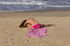 Yoga at the beach of Goa. A beautiful girl in a red bikini is performing yoga at the beach of Goa Stock Images