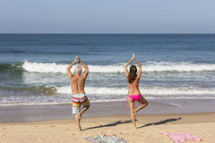 Yoga at the beach of Goa. Two persons are doing yoga in the early morning at the beach of Goa Royalty Free Stock Photo