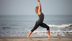 Yoga. At the beach of India stock video footage