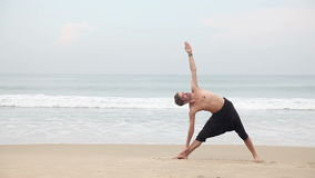 Yoga on the beach stock video footage