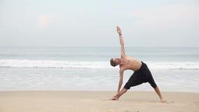 Yoga on the beach stock video footage