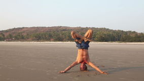 Yoga on the beach stock video