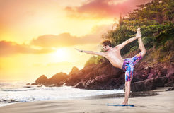 Yoga on the beach Stock Photo