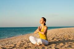 Yoga on the beach at sunrise. Stock Image