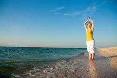 Yoga on the beach at sunrise. Stock Image