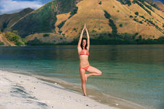 Yoga on the beach Royalty Free Stock Photo