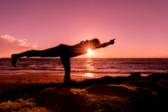 Yoga on the Beach at Sunset Stock Photo