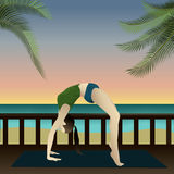 Yoga on beach (Upward Bow). Young girl practicing yoga on the beach with sunset Royalty Free Stock Image