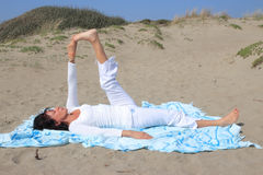 Yoga on the beach Stock Image