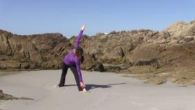 Yoga on the Beach stock footage