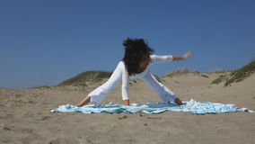 Yoga on the beach. Woman practicing Yoga on a shore stock video footage