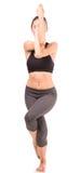 Yoga. Beautiful slim woman doing yoga exercise on white background Stock Photo