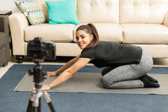 Yoga blogger giving some advice on video. Portrait of a beautiful young Hispanic yoga blogger giving some fitness advice on video Stock Image
