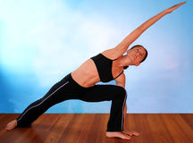 Yoga on Blue. Beautiful young woman practicing yoga Royalty Free Stock Image