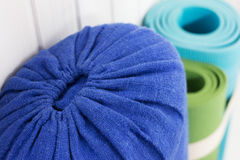 Yoga bolster and carpets Stock Photo