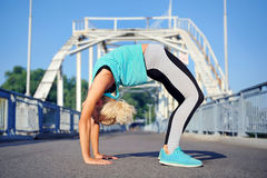 Yoga bridge pose on steel bridge background Stock Photo