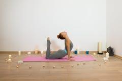 Yoga among candles Royalty Free Stock Photography