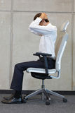 Yoga on chair in office - business man exercising Royalty Free Stock Photo