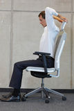 Yoga on chair in office - business man exercising Stock Photos