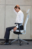 Yoga on chair in office - business man exercising Stock Photography