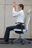 Yoga on chair in office - business man exercising Royalty Free Stock Photos