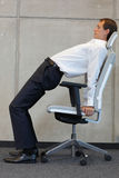 Yoga on chair in office - business man exercising. Yoga on chair in office - caucasian business man exercising Stock Photos
