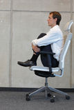 Yoga on chair in office - business man exercising Stock Images