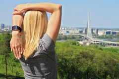 Yoga in the city : Woman meditating in yoga position in nature / park with city view close up. Royalty Free Stock Photos