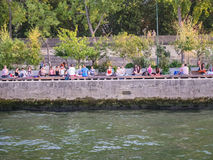 Yoga class on the banks of the Seine River Stock Photos