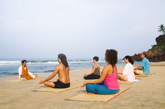 Yoga Class by the Beach Having Breathing Exercise Royalty Free Stock Image
