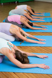 Yoga class in childs pose in fitness studio Stock Photo