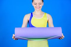 Yoga class concept. Yoga hobby and sport. Practicing yoga every day. Girl slim fit athlete hold fitness mat. Fitness and stock photos